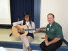 Over 25 companies participated in the Pottstown High School Career Summit.  <br /> Skipper Beltz, 1989 PHS graduate and the current director of product management at Martin Guitars, spoke about the challenges of his position and the need to learn the role of modern technology in the field of production. He also brought along an acoustic guitar valued at over $10,000.  He is pictured with Pottstown student Andria Rich who had previously authored her own song.<br /> <br /> Submitted by Pottstown School District