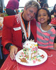 The second grade students at Schwenksville Elementary School in the Perkiomen Valley School District enjoy learning about winter holidays celebrated around the world.  Originally a German tradition, the second graders all participated and made their own gingerbread houses. <br /> Pictured is  Isadora DelaCruz with her mother.<br /> <br /> Submitted by Swenksville Elementary School