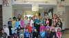 """Schwenksville Elementary school-wide Martin Luther King, Jr. Day HERO's (Help, Encourage and Respect Others) Project:  """"We are all a peace of the puzzle.""""<br /> HERO's representatives delivered large puzzle """"peaces"""" to all classroom teachers.  The students decorated these with images and words describing peaceful behavior/actions.  The puzzle was then put together and displayed in the building.  <br /> Pictured is the HERO's group with the final display.<br /> <br /> Submitted by Perk Valley School District"""