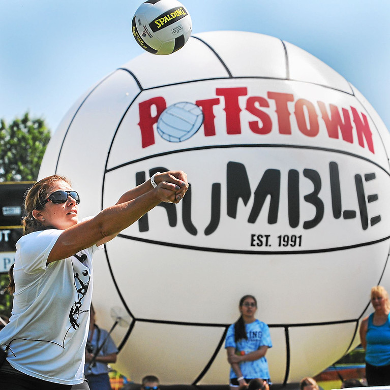 . Olympic gold medalist Misty May-Treanor demonstrates how to hit the volleyball during her youth volleyball clinic held at Memorial Park in Pottstown Thursday morning. May-Treanor worked closely with several hundred kids from 8 to 18 years old in the clinics, which are part of this year\'s Volleyball Rumble. (Photo by John Strickler/The Mercury)