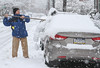 Pottstown resident Joe Couto clears the fresh snow from his car rooftop.<br /> Photo by Kevin Hoffman, The Mercury