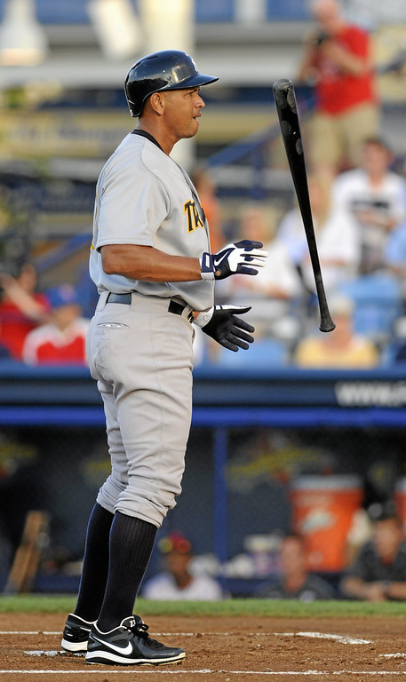 . New York Yankees third baseman Alex Rodriguez flips his bat after a called strike in the first inning of play in a Class AA baseball game with the Trenton Thunder against the Reading Phillies, Monday, July 15, 2013, in Reading, Pa. Rodriguez is doing a rehab assignment with the Thunder recuperating from hip surgery. (AP Photo/Bradley C Bower)