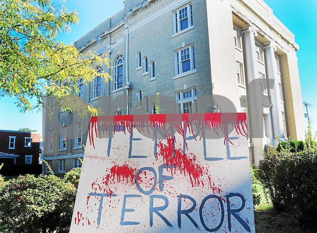 . An eerie  billboard lets area residents know that the upcoming \'Temple of Terror\' haunted house will be held inside the Stichter Lodge #254 at 20 N. Franklin St. in Pottstown, Pa. (Photo by John Strickler/The Mercury)