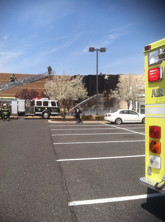 . Fire damages the facade of the Kohl\'s Department Store in Limerick, Pa., on Friday, April 25, 2014. (Photo by John Grayshaw)