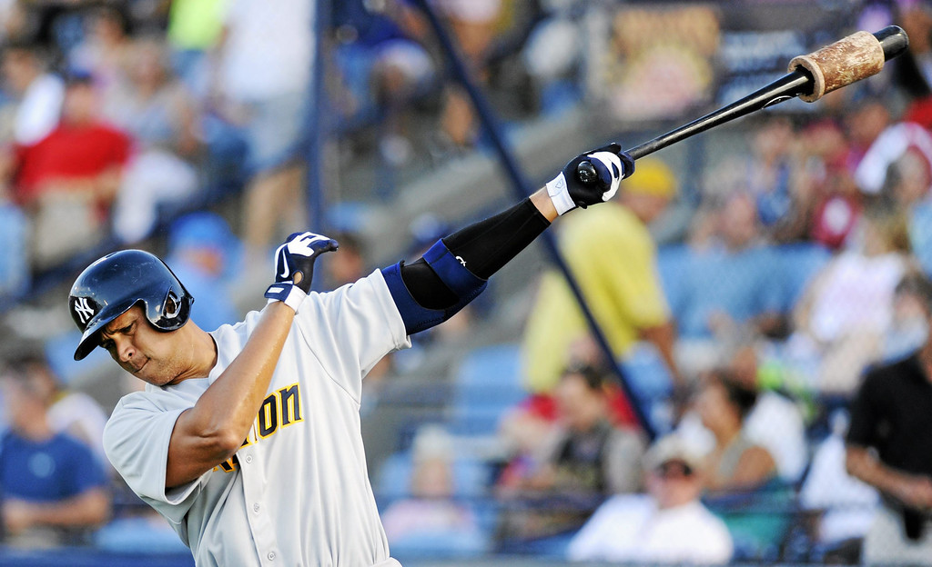 . New York Yankees\' Alex Rodriguez takes warm up swings in the on deck circle in the first inning of a Class AA baseball game with the Trenton Thunder against the Reading Phillies, Monday, July 15, 2013, in Reading, Pa. Rodriguez is doing a rehab assignment with the Thunder recuperating from hip surgery. (AP Photo/Bradley C Bower)