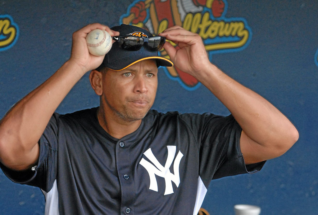 . New York Yankees third baseman Alex Rodriguez heads out to batting practice before a Class AA baseball game with the Trenton Thunder against the Reading Phillies, Monday, July 15, 2013, in Reading, Pa. Rodriguez is doing a rehab assignment with the Thunder recuperating from hip surgery. (AP Photo/Bradley C Bower)
