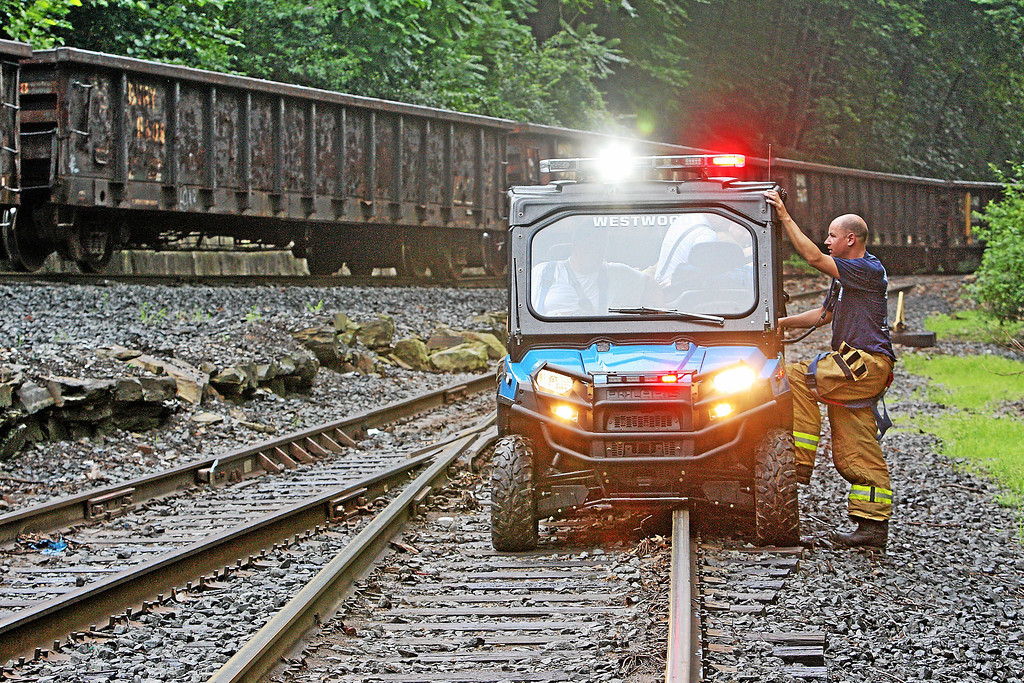 . A Westwood Fire Company ATV and crew are on the scene of a train derailment in Valley, Chester County, on Monday, July 8, 2013. Two of the train cars fell into the Brandywine Creek. The cars were empty and there was no spill.