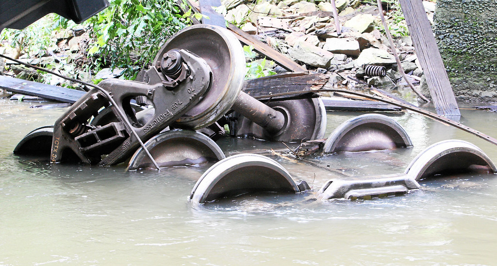 . The undercarriage of train cars sit in the creek following a train derailment in Valley, Chester County, on Monday, July 8, 2013.