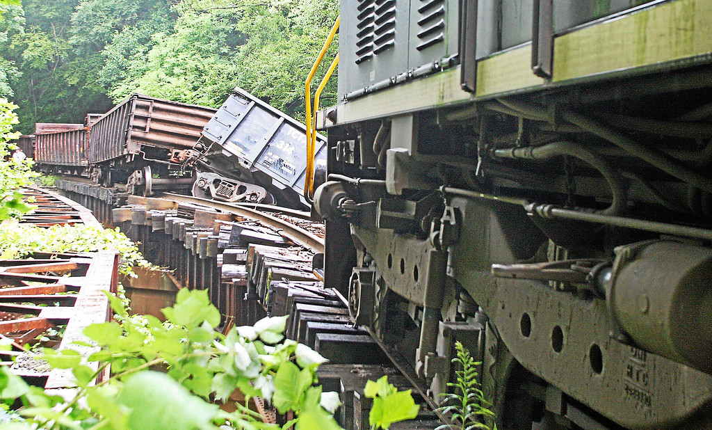 . Damage to a rail line can be seen near where two empty train cars went off a bridge into the Brandywine Creek in Valley, Chester County, on Monday, July 8, 2013.