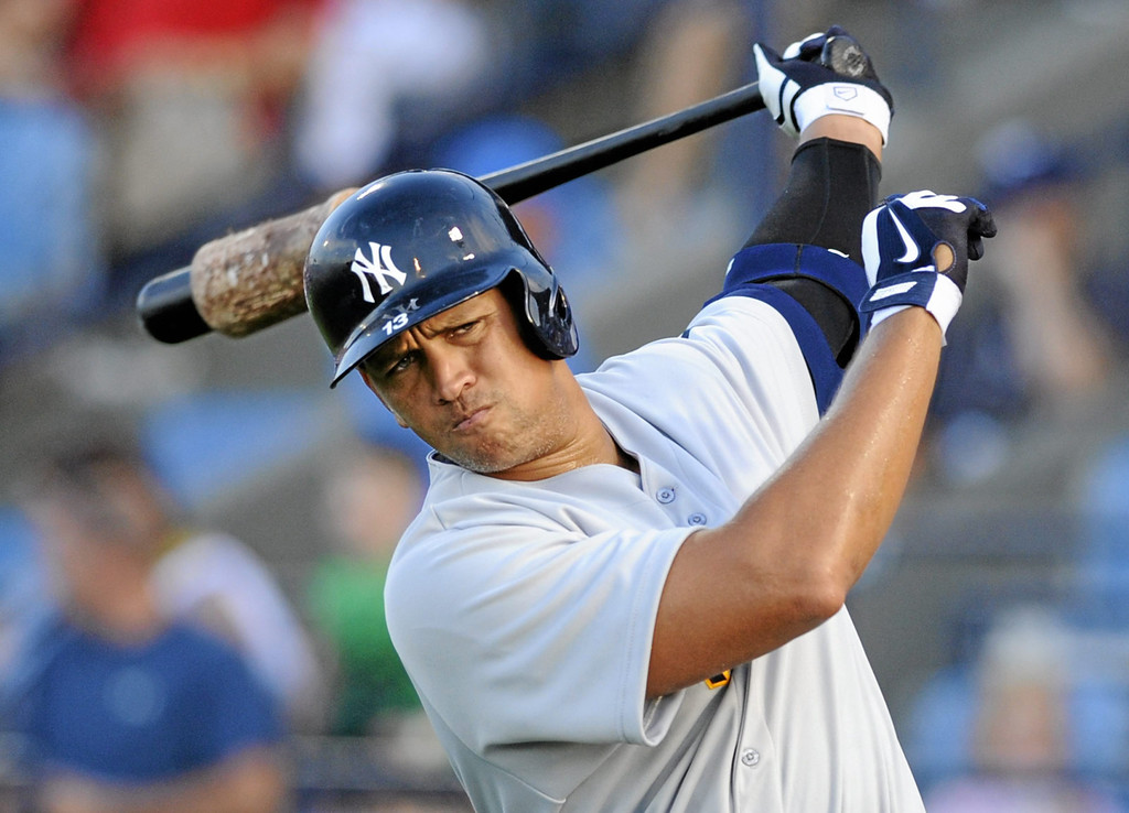 . New York Yankees Alex Rodriguez takes warm up swings in the ondeck circle in the first inning of a Class AA baseball game with the Trenton Thunder against the Reading Phillies, Monday, July 15, 2013, in Reading, Pa. Rodriguez is doing a rehab assignment with the Thunder recuperating from hip surgery. (AP Photo/Bradley C Bower)