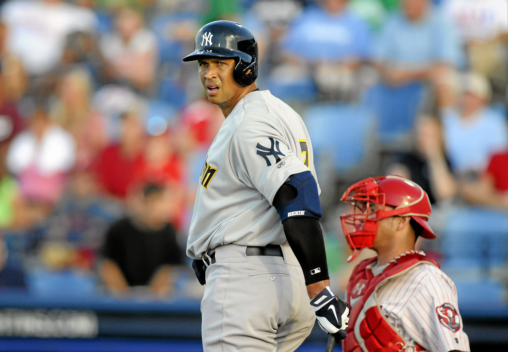 . New York Yankees\' Alex Rodriguez, left, looks from the plate during his first at-bat during a Class AA baseball game with the Trenton Thunder against the Reading Phillies, Monday, July 15, 2013, in Reading, Pa. Rodriguez is doing a rehab assignment with the Thunder recuperating from hip surgery. (AP Photo/Reading Eagle, Jeremy Drey)