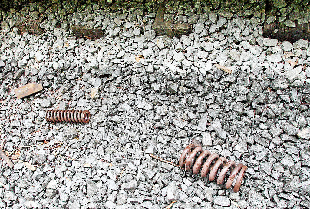 . Springs from the undercarriages of a train car lay about 100 yards up the rail line following a train derailment in Valley, Chester County, on Monday, July 8, 2013.